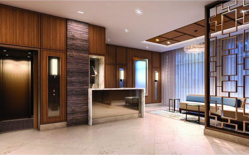 Beautifully appointed walnut paneled lobby